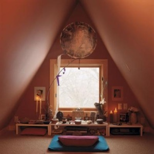A small meditation space located in an attic.