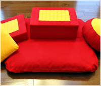 Square meditation cushion stuffed with synthetic hard foam.