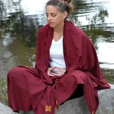Woman meditating wrapped in a Pashmina from chopa.com
