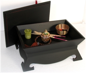 Small portable altar with storage space inside.